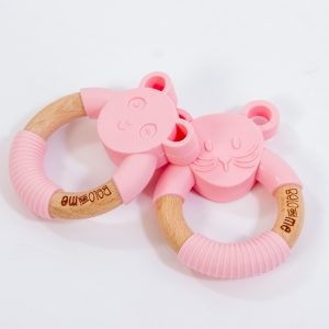 Pretty Penny Panda teether in Pink is made from gum-soothing silicone and lightweight wood. They're perfect for little hands to hold!
