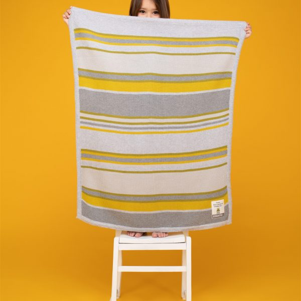 grey and yellow cosatto blanket
